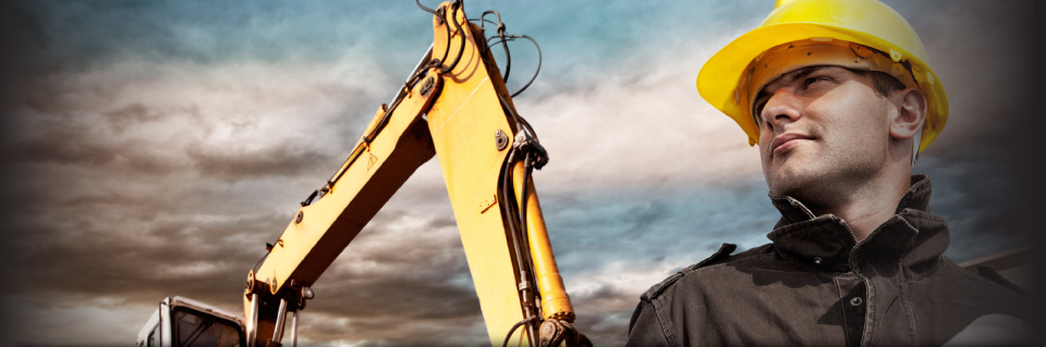 Man wearing hard hat next to excavator